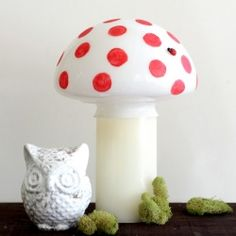 Use an old ceiling fan light fixture and a LED Candle to create a mushroom nightlight.