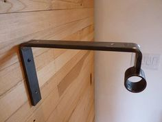 This Industrial shelf and garment bracket was designed with clothing display in mind (copper rod not included). It would be perfect for commercial or residential applications. Shelf surface is 10-1/2 long. Center of rod holder is 10-5/16 from wall and has 1-3/8 inside diameter with one