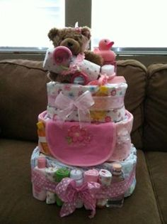 Finished product! This square diaper cake was sent in by Ashley. She used a different method to get the square shape. Instead of using all diapers, she wrapped the outside
