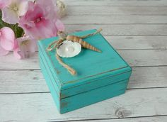 "Beach Wedding Ring Box Bearer Ring Box Ring Holder Personalized Ring Bearer Nautical Wedding Decoration Seashell Wedding Custom Color.    Rustic Chic Beach look. Perfect for your rustic beach wedding.     MATERIAL and DECORATION: Wooden box. Decorated on the lid with seashell, pearl and jute twine.     COLOR: ""Aqua marina"" (teal color) but you can choose your favorite color from the list. If you want a color than is not on the list, please, contact me. If you prefer the box in natural walnut…"