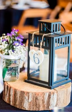 lantern centerpiece and table numbers, wood piece centerpieces, purple aster and baby's breath mason