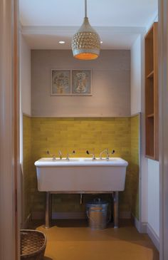 Wood trim instead of bullnose tile edging for a fresher look | Wanzenberg House  Tile Makes the Room | Remodelista