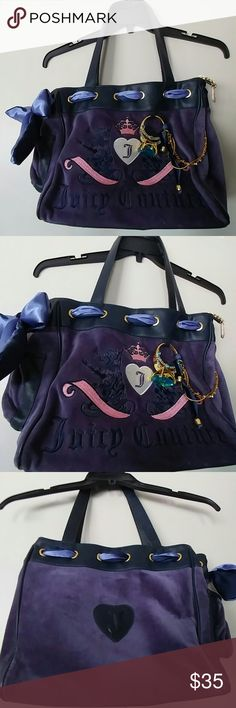 PURPLE JUICY COUTURE HANDBAG Plush, Purple Juicy Couture Handbag with leather trim and lots of bling!!  These colors Pop!!!  Plenty of space/pockets inside.  Side pocket outside.  Missing mirror inside as pictured.  Priced accordingly.  Gorgeous bag.  Mint condition.  Carried once.  Shoulder straps not long enough for my taste.  I'm a crossbody girl.  But you will love this bag! Juicy Couture Bags Shoulder Bags