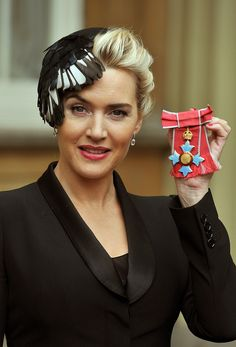 Kate Winslet collects CBE in Natalie Ellner hat.