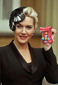Kate Winslet collects CBE in Natalie Ellner hat.