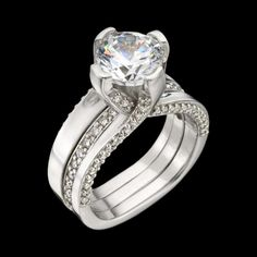 A modern engagement ring design by Adam Neeley.  Luxe diamond ring sparkles from every angle. This luxurious ring includes .96 carats total diamond weight of accent diamonds surrounding a sumptuous center diamond. The band removable wedding ring incorpora http://amzn.to/2rySlue