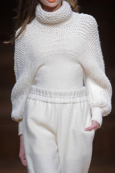 """""""...a funnel-neck sweater, both featuring an intriguing circular knit and the incorporation of varied knit gauges. That's technical stuff, but the sculptural effect transcended the technique""""   Christian Wijnants Fall 2013"""
