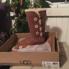 """Authentic UGGs! Tall, tan, Bailey Button Only out of box for pics! UGG Bailey style Button Triplet. Gorgeous traditional UGGs! This brand does stretch over time, but are the warmest, most comfortable boots on earth! My dad used to say, """"They must be so stylish because they're so ugly!"""" LOL! I couldn't live without at least 3 pairs in my actual closet al all times!!! UGG Shoes"""