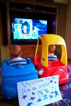 Toddler rainy day activity, a drive-in movie theatre.  Bring outside cars inside, pop popcorn, and watch a movie! *party idea - kids bring their cars to the backyard for a drive-in movie