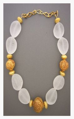 Etched irregular beads with detail beads and gold...