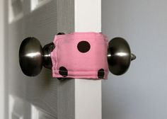This is brilliant! Make a door jammer so you can close or open baby's door without a sound! These are for sale on etsy for $8, but I can totally DIY this with fabric and two ponytail elastics!