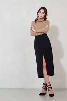 The Nectar Skirt - Add some length and some hot to your wardrobe. The Nectar Skirt is a midi skirt with a fitted high waist and front slit. There's a hook/zip closure in the back, and it's tight while still giving you room to move. Your sweaters, crop tops and the like will love this one.