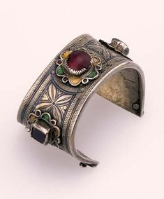 Morocco | Silver alloy, niello, enamel and glass bracelet from the Ida ou Semlal people of the western Anti-Atlas region | ca. early 20th century
