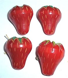 bakelite red strawberry buttons...