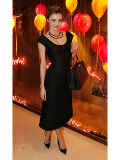 Miranda Kerr - Posing in a Breakfast at Tiffany's-esque ensemble—an LBD, clean heel, and short necklace—during Paris Fashion Week.