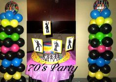 70's party balloons and cake