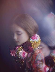 Embroidery stitching onto photographs by Izziyana Suhaimi