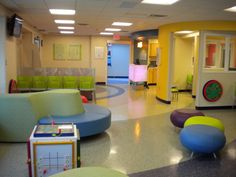 Emergency department waiting room at Dayton Children's with one of our wall mounted Round-a-bout toys.