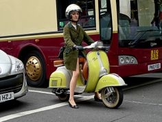 She rides colorfully on her Vespa (With Added Attitude) to work