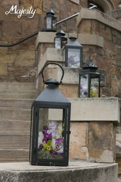 Floral filled lanterns line the stairs on the Castle Terrace at Glen Eyrie. Photo Credit: Majesty Photo