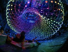 Parabolic Lovecloud responds to an individual viewer's heart rate with wave-like light animations. 'Parabolic Lovecloud' by amigo and amigo The Bait, Interactive Art, Light Installation, Lighting Design, Sculptures, The Incredibles, Animation, Heart Rate, Night