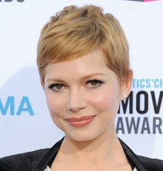 Michelle Williams' strawberry blonde pixie cut.  Slightly longer bangs for me to shorten the length of my face.