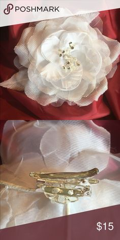 White Bridal Hairpiece/Pin Lot 1 This beautiful white colored bridal hairpiece is adorned with rhinestones, and pearls. The back has both a hair clip as well as a pin so it can be worn either way. Accessories Hair Accessories