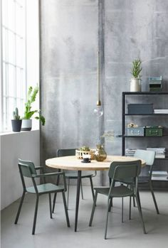 Industrial living room / dining room with picture frames, wooden ...