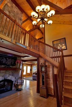 Post & beam mountain lodge stairs. Love that lofted ceiling!