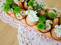 very cute easter decoration - made of eggshells in an eggbox as mini vases filled with little flowers