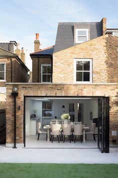 Hughes Developments completed a top to bottom redesign of this semi-detached Victorian house in South West London. The project included a basement dig to provide over 1,000 square feet of extra living space, plus a rear extension and loft conversion. The basements now house a home cinema, study, guest bedroom and steam room. The remainder read more Brick Extension, House Extension Plans, House Extension Design, House Design, Extension Ideas, Kitchen Extension Semi Detached House, 1930s Semi Detached House, Orangery Extension, Victorian Terrace House