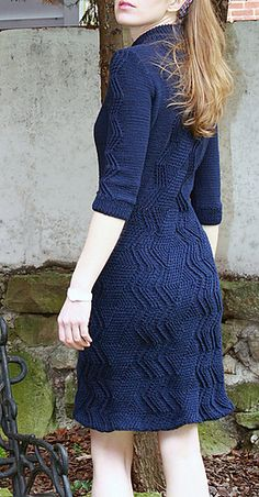 Twisted stitches build a graphic zigzag pattern across this close-fitting dress. Piece is knit in the round from the bottom up with three quarter sleeves.