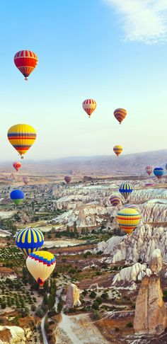 Hot air balloon flying over Cappadocia, Turkey. Travel the world and enrich your spirit. Brabbu inspiration. See more: http://www.brabbu.com/en/inspiration.php #top10traveldestinationsintheworld