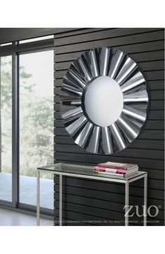Wavy Mirror - 850119Description :Wavy mirror is created by soft pleating on round reflective frame. Add to a modern vanity or living room for fun updated look. Mirror color options: gray, clear or black. Each mirror features brackets for hanging and wire includedFeatures :Color :ClearProduct Cover (Upholstery Material or Type of Metal) :MirrorProduct Finish (Structure Materiel or Type of Wood) :WoodDimensions :Mirror :36