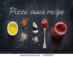 Pizza topping sauce ingredients or recipe on black background. Tomato puree, olive oil, garlic, oregano, salt and pepper from above - cooking food. - stock photo