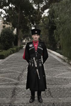 Royal Circassian (Adyghe) Guard of HM King of Jordan. Jan. 11, 2016 photo, 22 year-old Circassian guard Private Adnan Sami Bjanthala, poses for a photograph outside Basman Palace, in Amman, Jordan. Circassian guards, who have served Jordan's kings since the founding of the monarchy, still adhere to their ancient traditions, such as donning an incongruous cold weather uniform of black wool hats, red capes and leather boots in this desert climate. (AP Photo/N. El-M.)