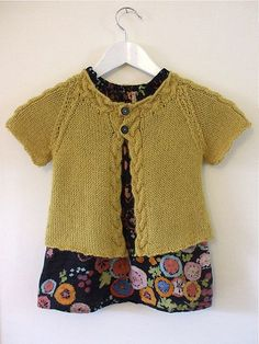 Inspiration photo: Simple top-down raglan short sleeved cardi with cabled button bands and neckline. The pattern lines are sober; no border finishings or details beside the cable; the colour choice has the floor ~~ {k14} Zeste | Flickr - Photo Sharing!