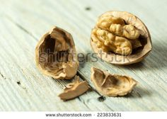 Walnuts on old wooden table - stock photo