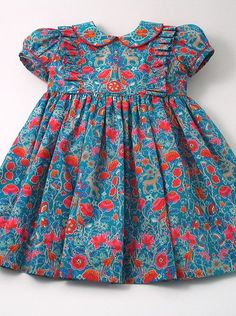 "Bloom"" Front Frill Dress -Liberty ""Palmeira Bloom"" Front Frill Dress - Liberty Tana Lawn Dress in navy blue ""Edenham"" print for A Little Girl Ladybird Girls Ditsy Floral Print Dress Girls Frock Design, Kids Frocks Design, Baby Frocks Designs, Baby Dress Design, Baby Girl Frocks, Frocks For Girls, Dresses Kids Girl, Kids Outfits, Dress Girl"