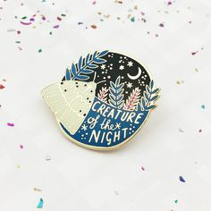 FREE UK SHIPPING on all badges! (Normal shipping applies when purchasing with other items from the shop…)  Little moths dancing in the light, glittering stars above and glowing florals at dusk have all played their part in inspiring the Creature of the Night limited edition mini collection...  This pin brooch features an original design by Lee May Foster-Wilson of a moth sitting next to the stars, looking to the moon as a guide in the dark. One for those of you who are yourselves, Creatures…