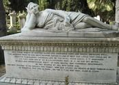 """THE RICHNESS OF DEATH—John Keats was not the only foreigner who came to Rome hoping the Italian sun would restore his health. Devereux Plantagenet Cockburn is shown with his beloved dog and wrapped in a blanket on the monument to him above. The first-born son of Sir William Cockburn """"was beloved by all who knew him, and most precious to his parents and family, who had sought his health in many foreign climes. He departed this life in Rome, aged 21 years.""""    Although it is p..."""