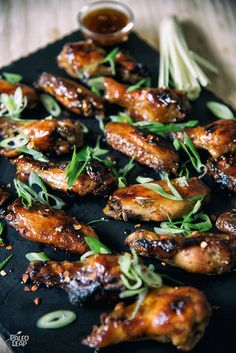 Thai-Style Chicken Wings - Bite into these caramelized chicken wings coated in a Thai-inspired sauce. Perfect to serve at a party!