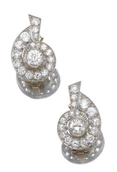 PAIR OF DIAMOND EARRINGS, 1930s. Each of swirl design set to the centre with a circular-cut diamond, the mount further set with circular- and single-cut diamonds, post and clip fittings, French assay marks.