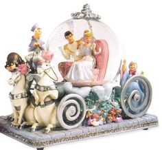 Cinderella Coach Snowglobe  Cinderella and Prince Charming are riding off into a happily ever after. The Fairy Godmother, coachman, horses, Jaq, Gus, Lucifer and others surround their regal carrigae. Rhinestones accent the horses collars and finial. Came with a 50th Anniversary hang tag.