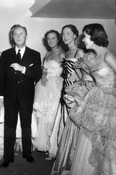 April 25 1950 - Christian Dior with six of his models after a fashion parade at the Savoy Hotel, London.