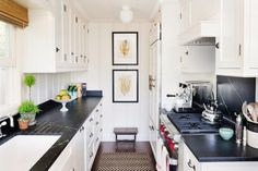 Traditional Kitchen With Black Marble Counters