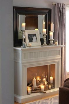 Romantic candlelit fireplace for the bedroom – Kamin Wohnzimmer Modern Living Room Decor Fireplace, Candles In Fireplace, Fake Fireplace, Modern Fireplace, Fireplace Design, Decorative Fireplace, Fireplace Decorations, Empty Fireplace Ideas, Christmas Fireplace Mantels