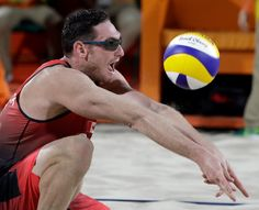 Canada's Josh Binstock digs against Italy during a men's beach volleyball match at the 2016 Summer Olympics in Rio de Janeiro, Brazil, Monday, Aug. 8, 2016. (AP / Marcio Jose Sanchez)