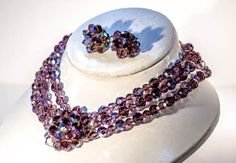 Vintage modernist Mid century jewellery set with 3 strand crystal necklace and clip earrings in amethyst glass.
