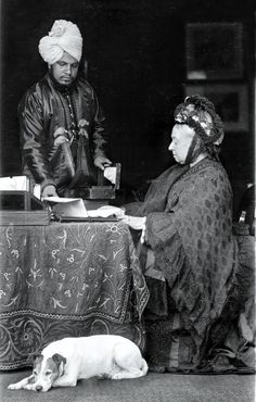 Strong bond: Queen Victoria at her desk, assisted by Abdul Karim in 1885 : she ate curry for breakfast every morning !